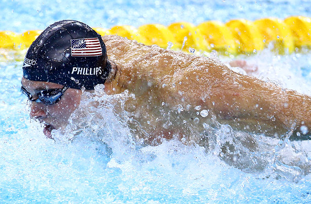 Ohio State University's Tim Phillips wins the first international medals of his career, winning both the 50m and 100m butterfly.