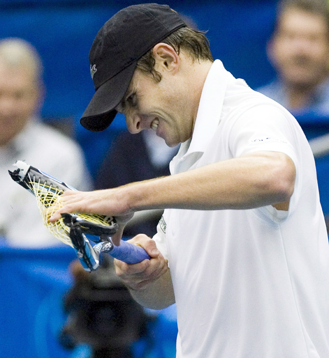 Roddick breaks his racket after losing a game in the second set of his match against Yen-Hsun Lu at the Regions Morgan Keegan Championships in Memphis.