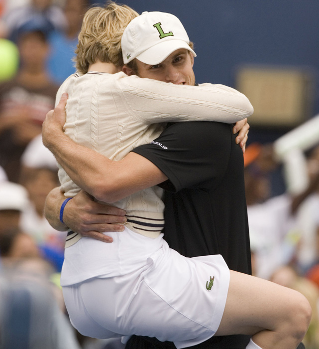 Ellen DeGeneres shares a warm embrace with Roddick during Arthur Ashe Kids Day at the National Tennis Center in Queens, N.Y.