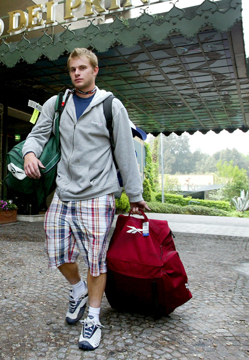 Roddick leaves Rome's Hotel Parco dei Principi after a fire started at the hotel.