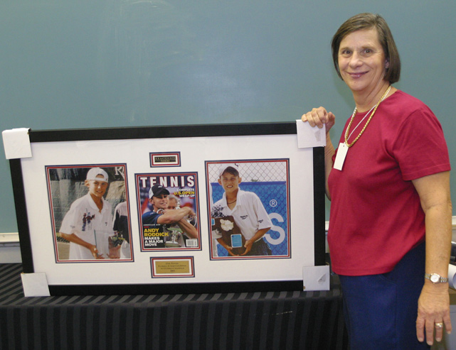 Roddick's mom, Blanche, with three framed and matted trophy photos of her son. The photos were a gift from USA Tennis.