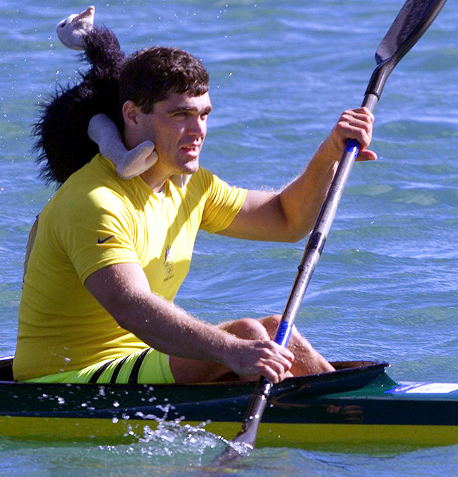 Well, this Australian emu is just a stuffed animal, but it still contributes to the Olympic sport of kayaking. Andrew Trim of Australia placed the stuffed Australian emu on his shoulders after the men's K2 500m kayak sprint at the Regatta Center at the Sydney Olympics.
