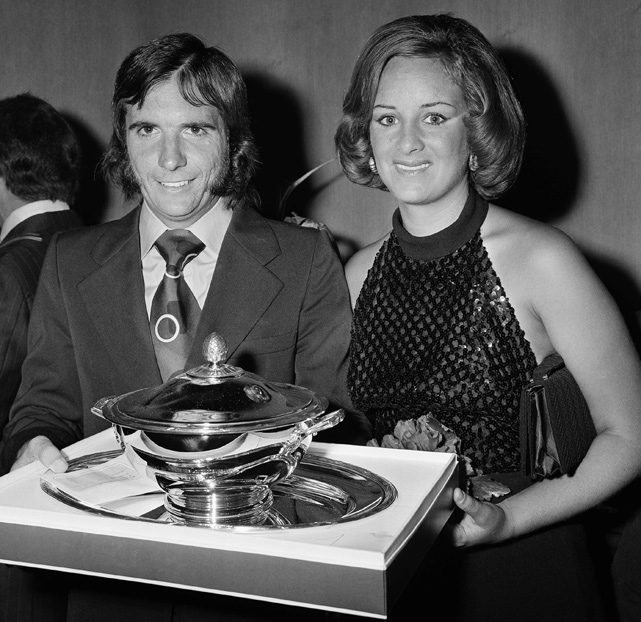 Brazilian auto racer Emerson Filttipaldi and his wife Maria Helena hold the 1972 Formula One Driver's Cup. The couple were married from 1970-82 and have three children.