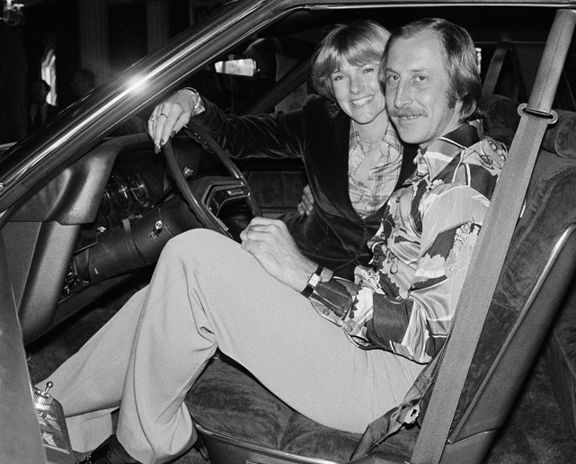 Fred Biletnikoff and his wife, Jennifer, sit in a new automobile presented to him for being the most valuable player in Super Bowl XI.