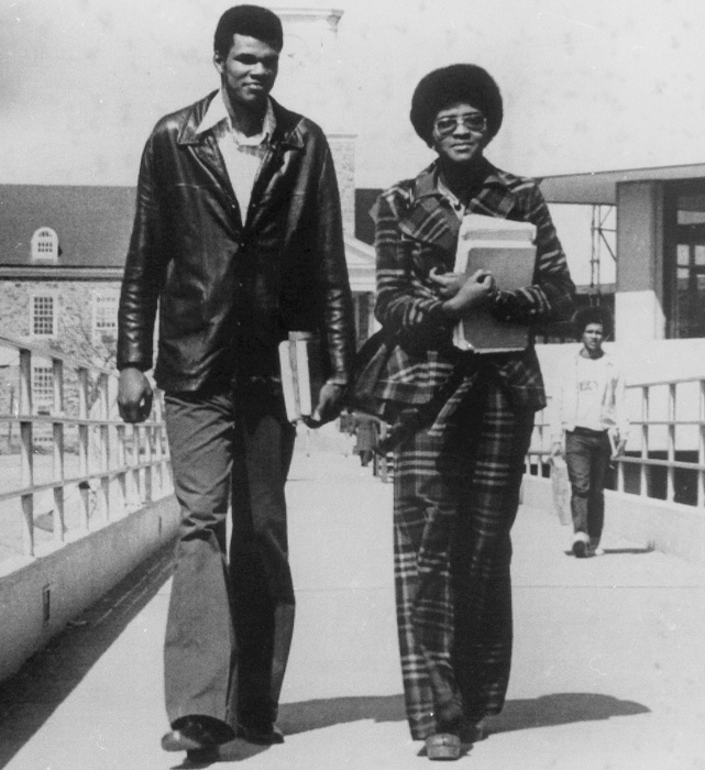 "College hoops star Marvin Webster, known as ""the Human Eraser,"" walks with his fiancee, Madeira Meadows, across the Morgan State campus in Baltimore."