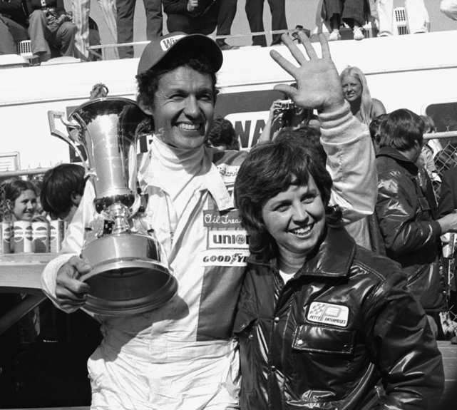 Richard Petty waves to the cheering crowds as he and his wife, Lynda, celebrate Petty's victory at the 1974 Daytona 500. The couple married in 1959 and have four children and 12 grandchildren.