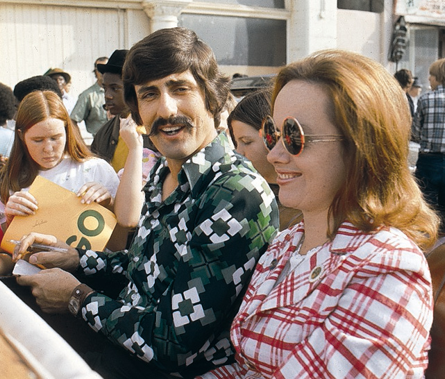 Oakland pitcher Rollie Fingers and his wife, Jill, enjoy the victory parade for the 1974 World Series winning squad. The couple married in 1967 and divorced seven years later.