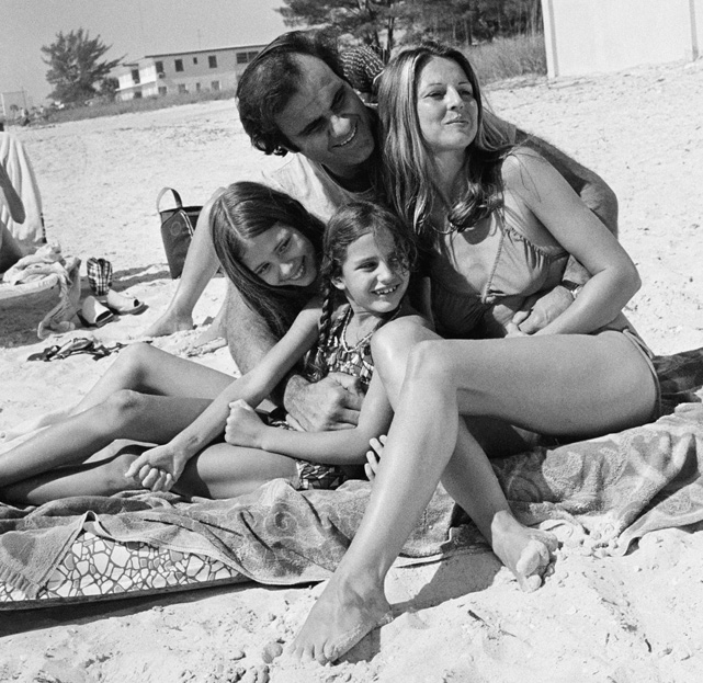 Mets infielder Joe Torre relaxes on the beach with wife Dani and daughters Lauren and Tina, during spring training sessions in St. Petersburg, Fla.