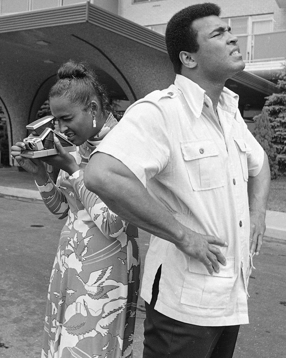 Muhammad Ali looks at the sky as his wife, Belinda, snaps a picture at the couple's house in Cherry Hill, Mich. The couple were married for 10 years (1967-77) and had four children together.