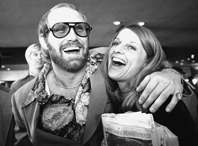 Terry Bradshaw and his girlfriend, Diane Murchison are all smiles as they depart from New Orleans after the Steelers beat the Vikings in Super Bowl IX.