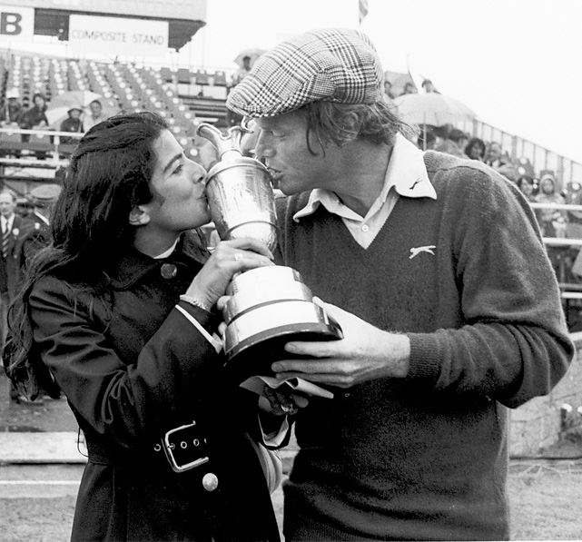 Tom and Linda Watson kiss the 1975  British Open trophy after Watson held off Jack Newton in a playoff match to claim the title. The Watsons were married for 25 years before divorcing in 1997.