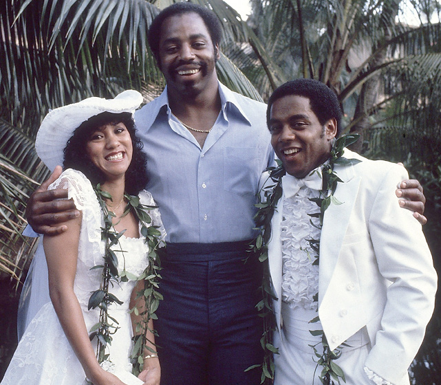 "Cowboys defensive end Ed ""Too Tall"" Jones stands between teammate Tony Dorsett and Julie Simon on the couple's wedding day. The romance didn't last long as the couple divorced four years later."