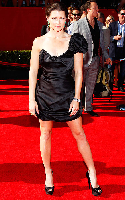 Danica Patrick always looks like one of the guys when she's in her racing jumpsuit. At the 2011 ESPYs, she rocks a black one-shouldered dress and sky-high platform heels - doubt any man wears this kind of attire.
