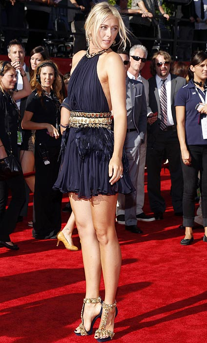 The ever-stunning Maria Sharapova glows in a short dress and sky-high heels at the 2011 ESPYs. But watch out - one stumble could cause a major mishap for the tennis star.  (Go to the last frame to vote on the best dressed athlete.)