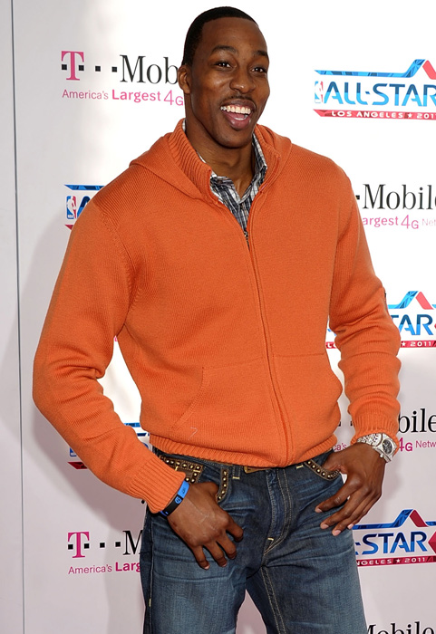 Dwight Howard pulls off this orange zip up without looking too much like a pumpkin.