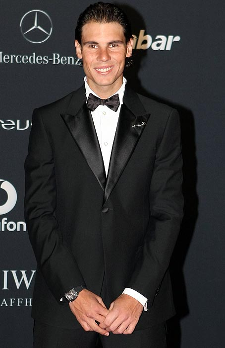 The best-looking part of Nadal's outfit, better than his sharp suit, snazzy watch and bowtie, is his crooked smile.
