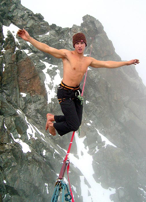 Austrian Michael Kemeter walks across the highest taut slackline at 3,770 meters altitude, battling blowing wind and snow.