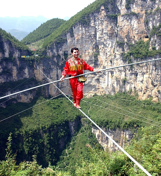 Uygur acrobat Ahdili successfully set a new Guinness world record by walking 2,254 feet on a high wire at a canyon in southwest China.