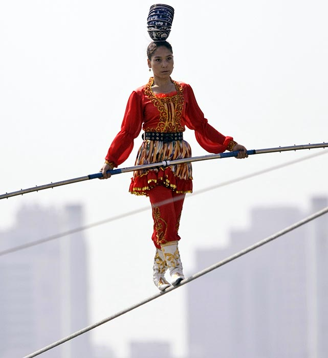 Aixiguli of China walks the high wire during the World High Wire Championships.