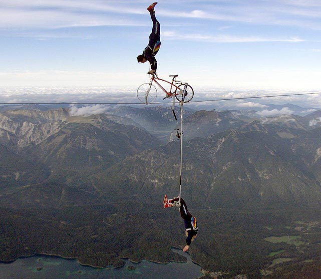 German high-wire artists Falco (top) and Tamara Traber perform at the Zugspitze, Germany's highest mountain, bordering Austria, at 2,963 meters. The stunt amid the mountain's peaks in Germany and Austria was meant to advertise tourism.