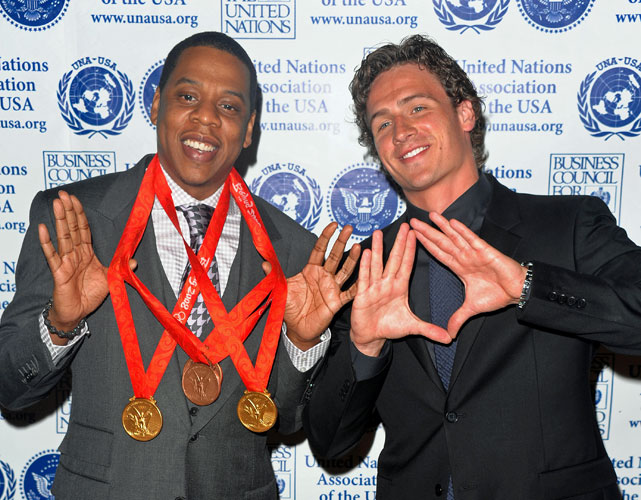 U.S. Olympic swimmer Ryan Lochte lets Jay-Z don his four medals from Beijing (two gold, two bronze) at the United Nations Association Global Leadership Awards Gala in 2008.