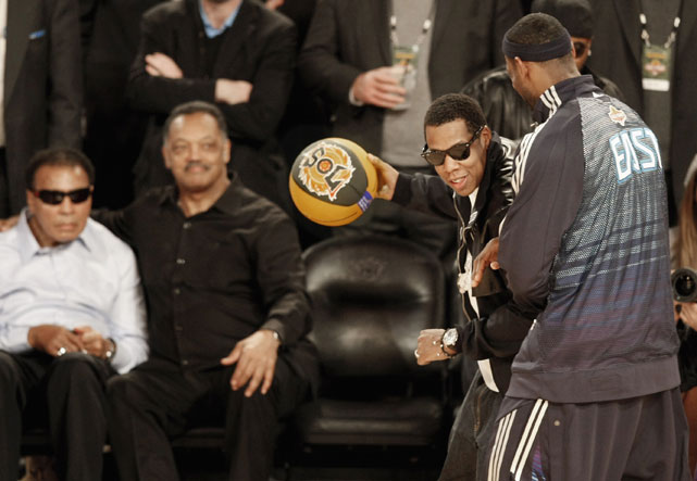 Jay-Z tries to take LeBron one-on-one as Muhammad Ali and Rev. Jesse Jackson watch.