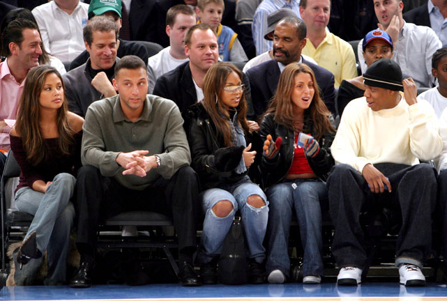 Yankees captain Derek Jeter, here in 2003, took in a Knicks game with singer Ashanti (with sunglasses), Jay-Z and two other women vying for his attention. The facial expressions of everyone in this photo are priceless.