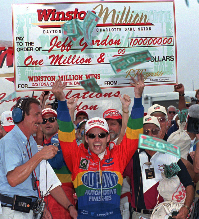 Gordon holds a $1 million paycheck after winning the Southern 500 race in 1997 for the third year in a row.