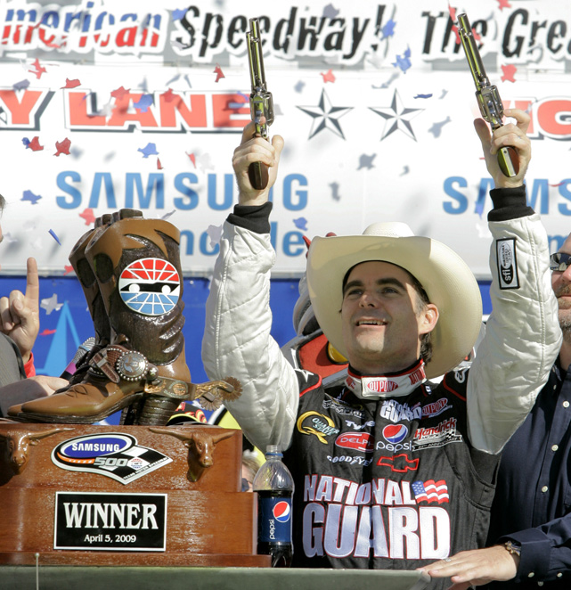 Gordon used a pair of pistols to celebrate his victory at the 2009 Samsung 500 at Texas.