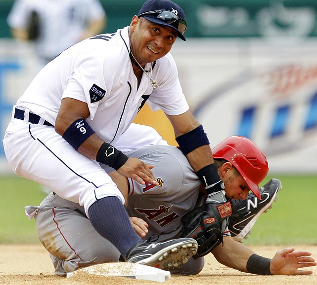 Second baseman Carlos Guillen was unable to complete a double play against the Angels. But he was able to get Jeff Mathis out at second, as well as fall on top of him.
