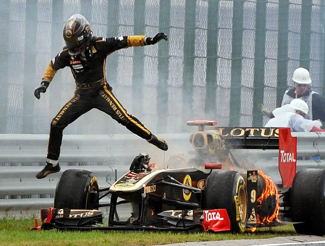 Formula One driver Nick Heidfeld of Germany leaps out of his burning car during the Formula One Grand Prix in Hungary.