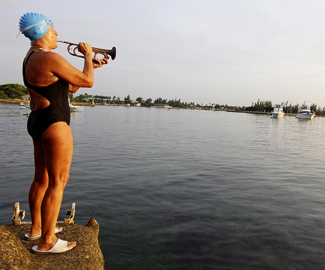 U.S. swimmer Diana Nyad plays 'Reveille' on a bugle before starting her attempt to swim a world record 103 miles (168 km) from Cuba to the U.S. on Aug. 7, 2011. The 61-year-old dove into the Straits of Florida with hopes to become the first to complete this swim without a shark cage. Unfortunately, Nyad was pulled from the water after 29 hours after battling asthma, shoulder pain and overall exhaustion.