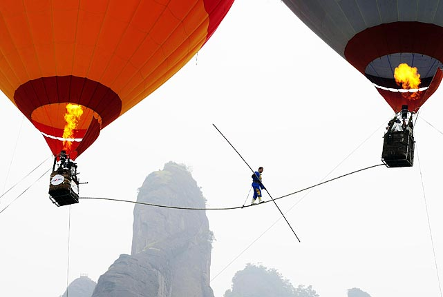 Saimaiti Aishan, a 27-year-old Uighur acrobat of tightrope walking, made history when he was the first person to walk a tightrope between two hot air balloons. He set a national tightrope walking record at 30 meters high on Aug. 6, but failed in his attempt of 100 meters.
