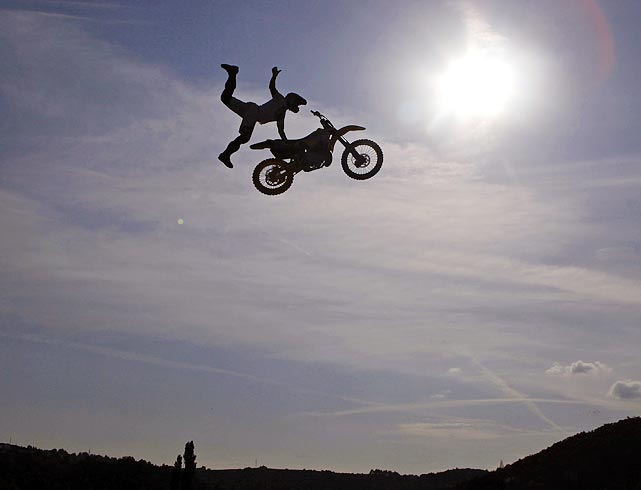 A rider soars above the horizon during FMX, a freestyle motocross event in Prague.