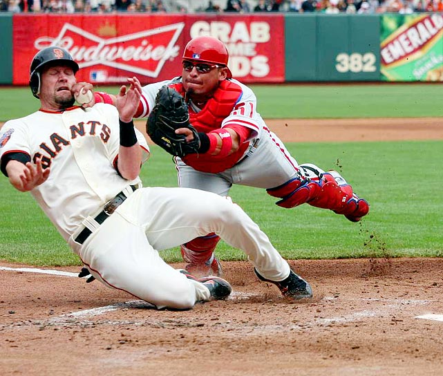 Aubrey Huff of the San Francisco Giants faces a knuckleball at home plate from Philadelphia Phillies catcher Carlos Ruiz.