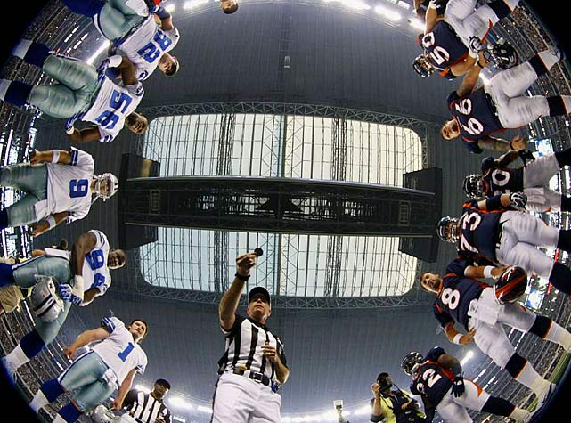 Referee Terry McAulay performs the coin toss before the start of last Thursday's Dallas-Denver exhibition opener for both teams at Cowboys Stadium. With this view, you can see the Cowboys' losing side of the coin; at least they won the game 24-23.