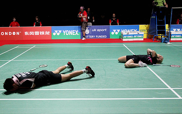 England's Chris Adcock (left) and Scotland's Imogen Bankier appear to be disappointed but are really elated after winning their mixed doubles semifinal at the Badminton World Championships.