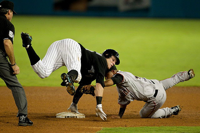 Florida Marlins' Logan Morrison appears to be playing a game of Twister wtih San Francisco Giants second baseman Orlando Cabrera. In reality, Morrison is tagged out after trying to stretch a single into a double at Sun Life Stadium in Miami.