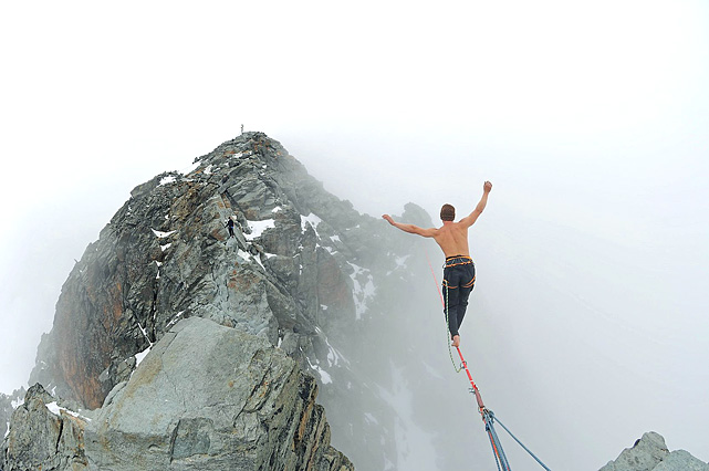 Austrian Michael Kemeter has little room for error as he walks across the highest taut slackline in Austria. Battling blowing wind and snow at 3,770 meters altitude, the 23-year-old walks over the Palaviccini-channel on a two and a half centimeters wide and 45 meters long slackline.