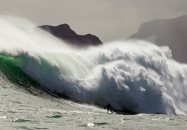 Mike Schlebach from South Africa surfs a simply monstrous wave at an offshore reef off Cape Town, South Africa. Surfers who can ride the Cape's biggest winter swells are eligible for the Rebel Sessions Awards, which recognize the best surfing over a season of big waves in Cape Town.