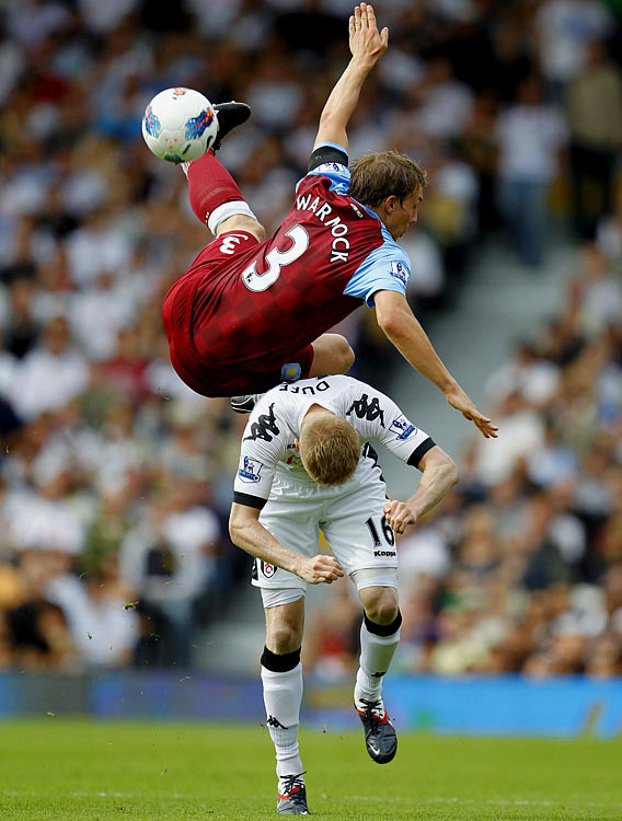 It's a bird, it's a plane, it's Aston Villa's Stephen Warnock as he flies through the air over Fulham's Damien Duff during a Premier League match at Craven Cottage.