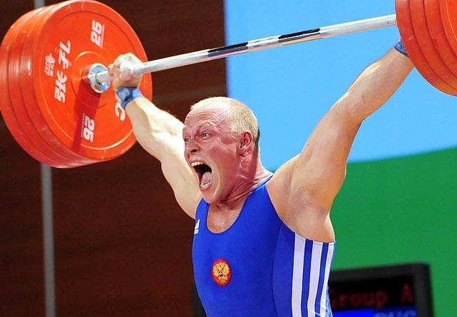 Russian Demanov Andrey successfully completes his lift in the 94kg weightlifting competition at the World University Games. Andrey won the gold medal, lifting a total of 390kg.