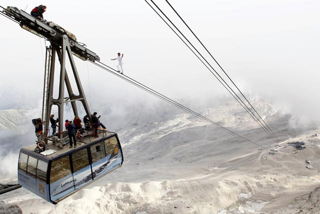 Freddy Nock from Switzerland balances on the ropeway of a cable car leading to Zugspitze, Germany's highest mountain (9,718 feet). Nock walked on the 995-meter long rope to break his own world record as part of a charity event.