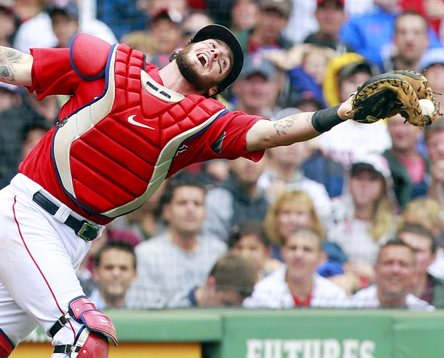 Boston Red Sox's catcher Jarrod Saltalamacchia barely snags a pop up foul from Tampa Bay Rays' Kelly Shoppach's in the first game of the teams' doubleheader.