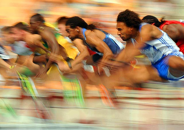 The United States' Jason Richardson (center) is nothing but a blur during the heats of the 110 meter hurdles at the IAAF World Championships in Daegu, South Korea. After a controversial DQ, Richardson won gold in the event.