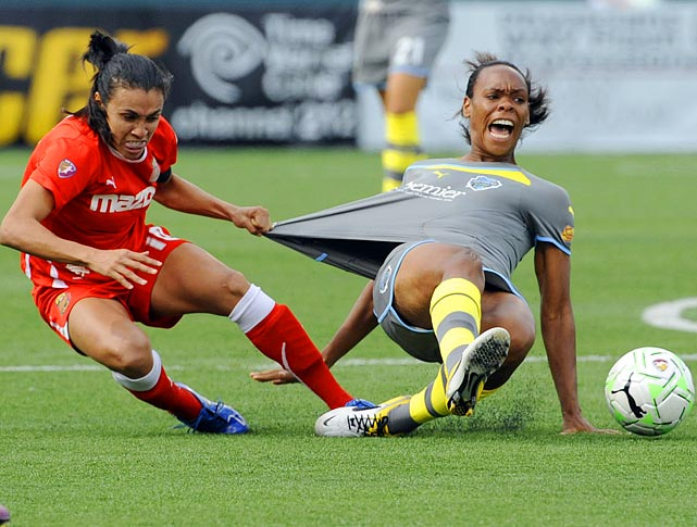 Western New York Flash forward Marta (left) does not approve of Philadelphia Independence defender Kia McNeill's fashion choices during the WPS Championship Game.