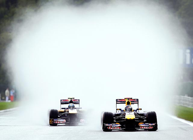 German Formula One driver Sebastian Vettel shows off his secret racing tactic: smoke bombs. Not really - his car just overheated during a practice session at the Spa-Francorchamps race track.