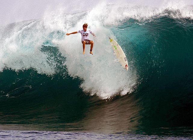 Instead of surfer Matt Wilkinson riding his board, the wave in Tahiti takes over and rides his board.