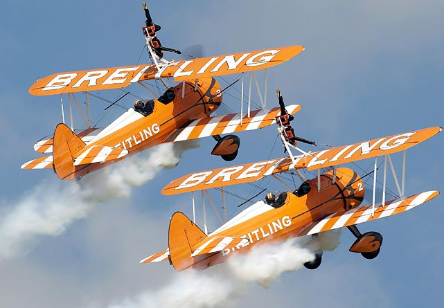 Two British Breitling Wingwalkers aircrafts perform during an airshow recognizing the 100th anniversary of the La Blecherette airfield in Switzerland.