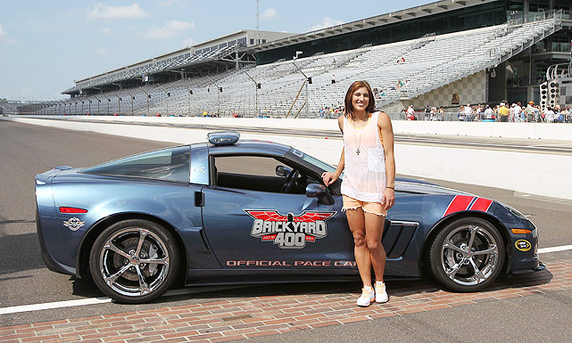 U.S. soccer star Hope Solo poses with the pace car at the Brickyard 400 at Indianapolis in July 2011.